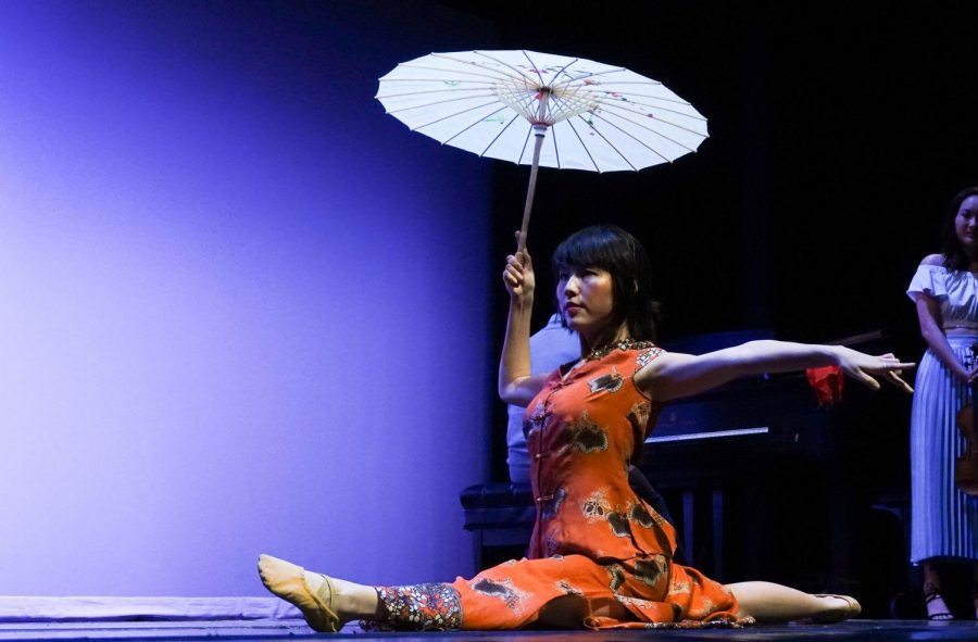A dancer performs with the Instrument Ensemble at LNYF.
