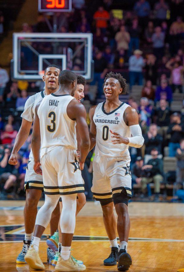 Maxwell+Evans+%283%29+and+Saben+Lee+%280%29+celebrate+Vanderbilt%27s+upset+victory+over+No.+18+LSU+on+Wednesday+night.