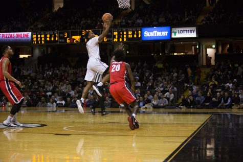 Saben Lee goes up for a layup over Rayshaun Holmes in Vanderbilt