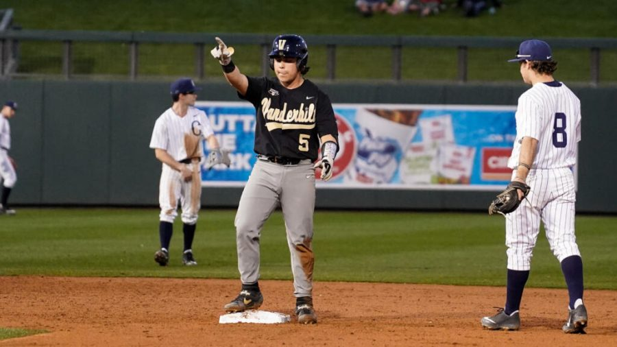 Vanderbilt catcher CJ Rodriguez points to the dugout after his double against UConn, one of his four hits on the day.