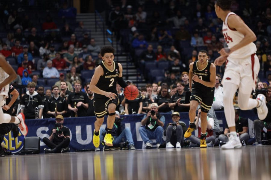 Scotty Pippen Jr. (2) pushes the ball up the court as Dylan Disu (1) trails in Vanderbilt's loss to Arkansas.