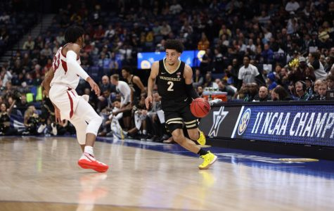 Scotty Pippen Jr. drives on Jimmy Whitt Jr. in Vanderbilt's SEC Tournament loss to Arkansas on Wednesday night.
