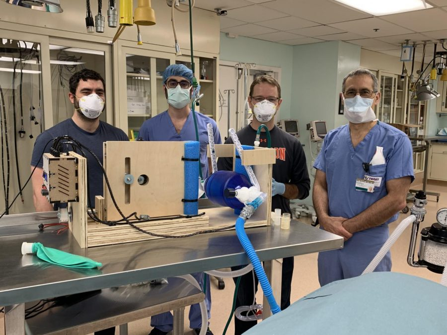 Left to right: Joshua Gafford, Andrew Tumen, Robert Webster and Matthew Bacchetta stand with their mechanism as it's tested (Photo courtesy Matthew Bacchetta)