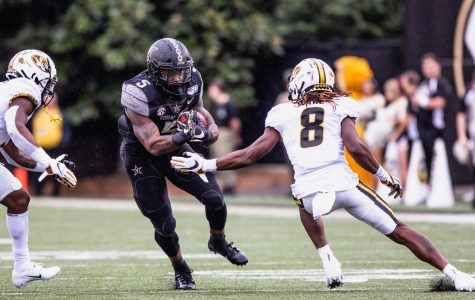Ke'Shawn Vaughn takes a handoff against the Missouri Tigers (Photo by: Hunter Long)