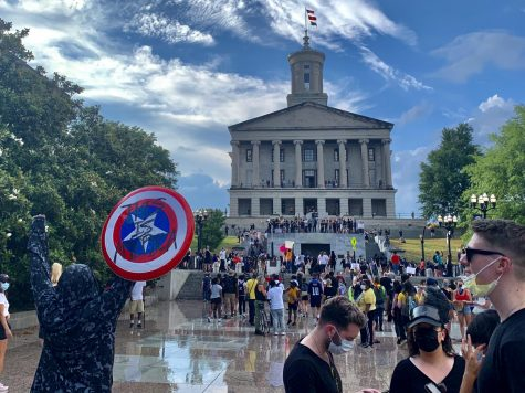 A protestor held up a Captain America shield in front of the Tennessee State Capitol.