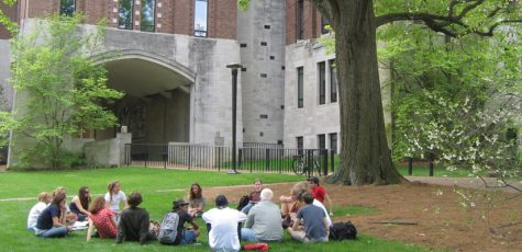 Students sit on lawn outside of Calhoun Hall.