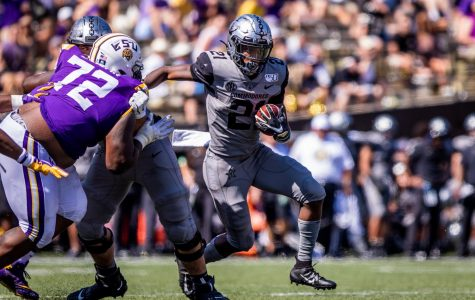 Keyon Brooks rushing against LSU last September in the Commodores 66-38 loss