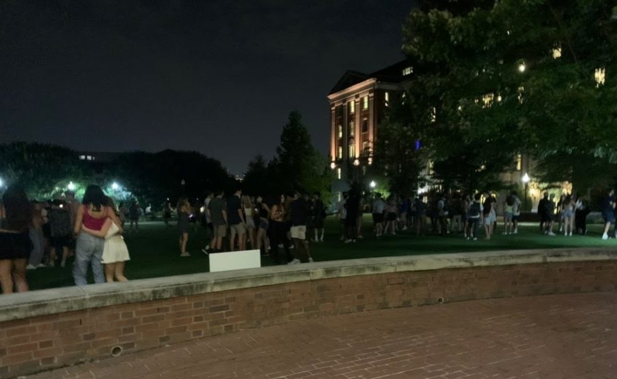 Students convening at the Lower Quad lawn on Commons.