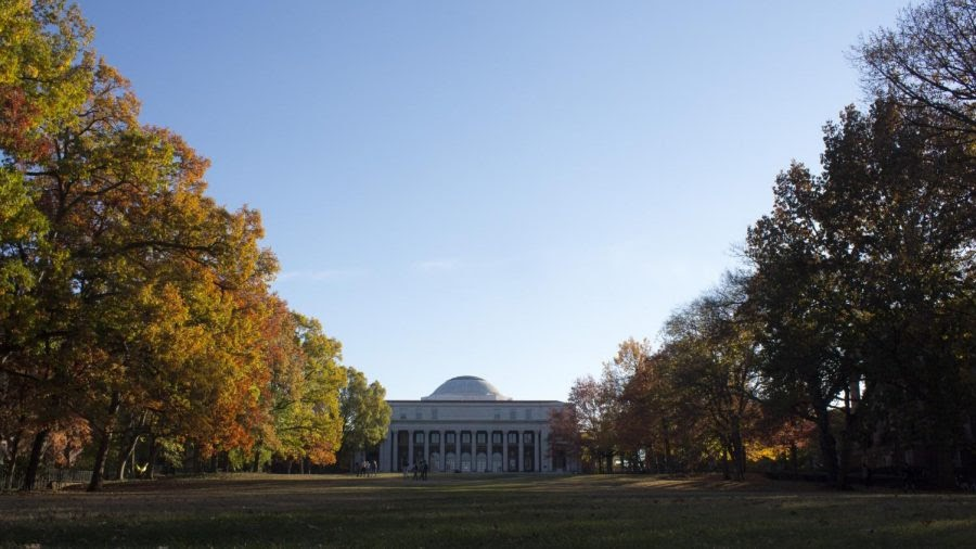 image of white dome of wyatt building late in the day. the sky is clear and the leaves on the trees are just starting to turn from green to orange