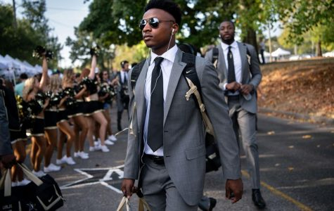 Camden Coleman takes place in the Commodores pregame walk before a game in 2019. (The News-Gazette)