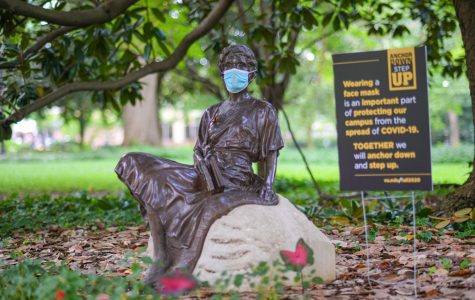 """Masked statues are among many visual displays on campus that remind us to """"Anchor Down, Step Up."""" (Hustler Multimedia/Hunter Long)"""