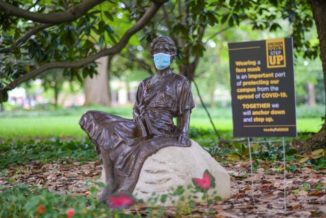"Masked statues are among many visual displays on campus that remind us to ""Anchor Down, Step Up."" (Hustler Multimedia/Hunter Long)"