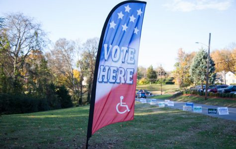 """A sign reads """"vote here"""" in front of campaign yard signs for Nashville's 2018 local candidates. (Hustler Multimedia/Claire Barnett)"""