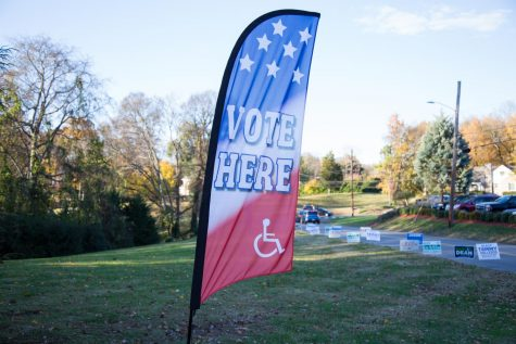 "A sign reads ""vote here"" in front of campaign yard signs for Nashville's 2018 local candidates. (Hustler Multimedia/Claire Barnett)"
