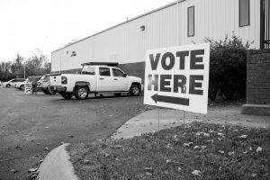 "A sign reads ""vote here"" outside of a Nashville 2019 polling location. (Hustler Multimedia/Claire Barnett)"