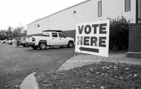 """A sign reads """"vote here"""" outside of a Nashville 2019 polling location. (Hustler Multimedia/Claire Barnett)"""