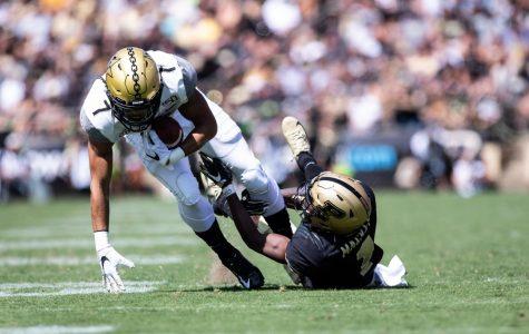 Cam Johnson breaks a tackle against Purdue in 2019. (Hustler Multimedia/Hunter Long)