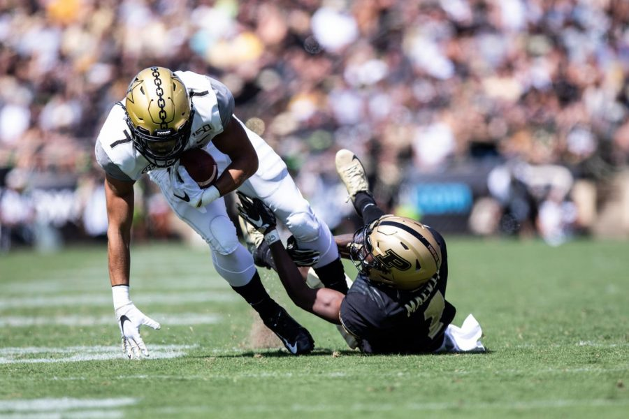 Cam Johnson breaks a tackle against Purdue in 2019. (Hustler Multimedia/Hunter Long)