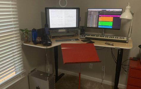 Pictured is choir director Dr. Tucker Biddlecombe's workspace setup for editing and mixing choir audio recordings (Hustler Staff/Sophie Heinz)