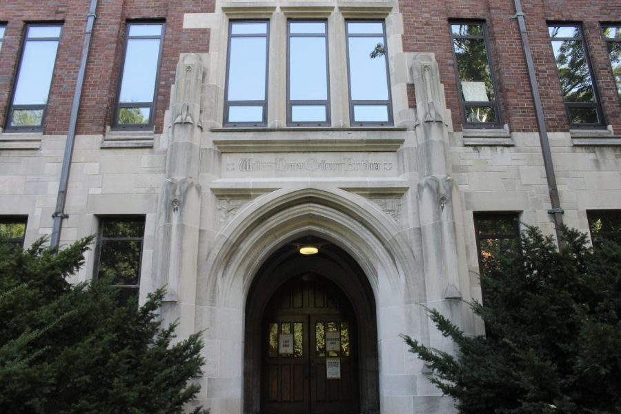 stone arch reading William Calhoun Hall above wooden doors