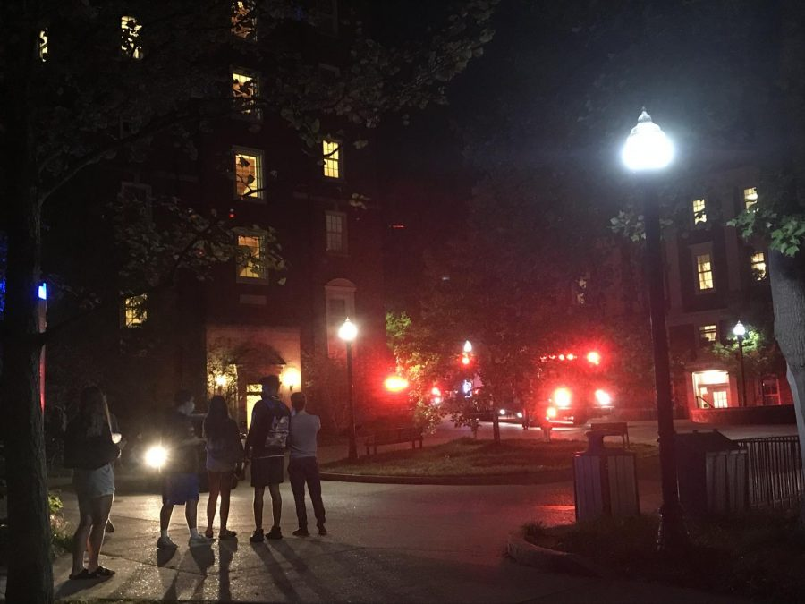 Students stand outside watching as firefighters address a dryer that caught fire in the Crawford laundry room Sept. 27.  (Hustler Multimedia/Chloe Postlewaite)