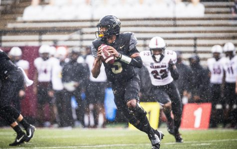 Mike Wright scrambles out of the pocket in Vanderbilt's 41-7 loss to South Carolina (Hustler Multimedia/Hunter Long)