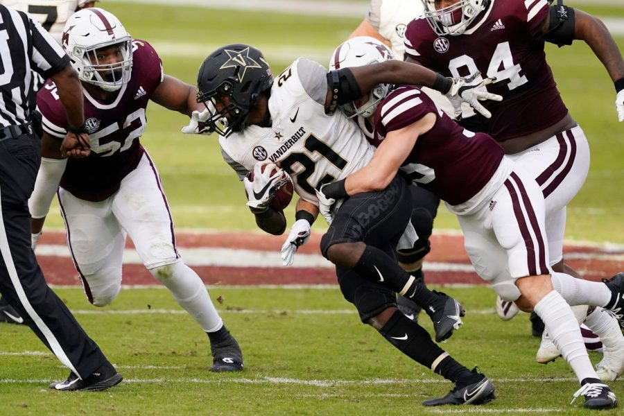 Keyon Henry-Brooks gets tackled in Vanderbilt's 24-17 loss to Mississippi State on Saturday, Nov. 7, 2020. (AP Photo/Rogelio V. Solis)