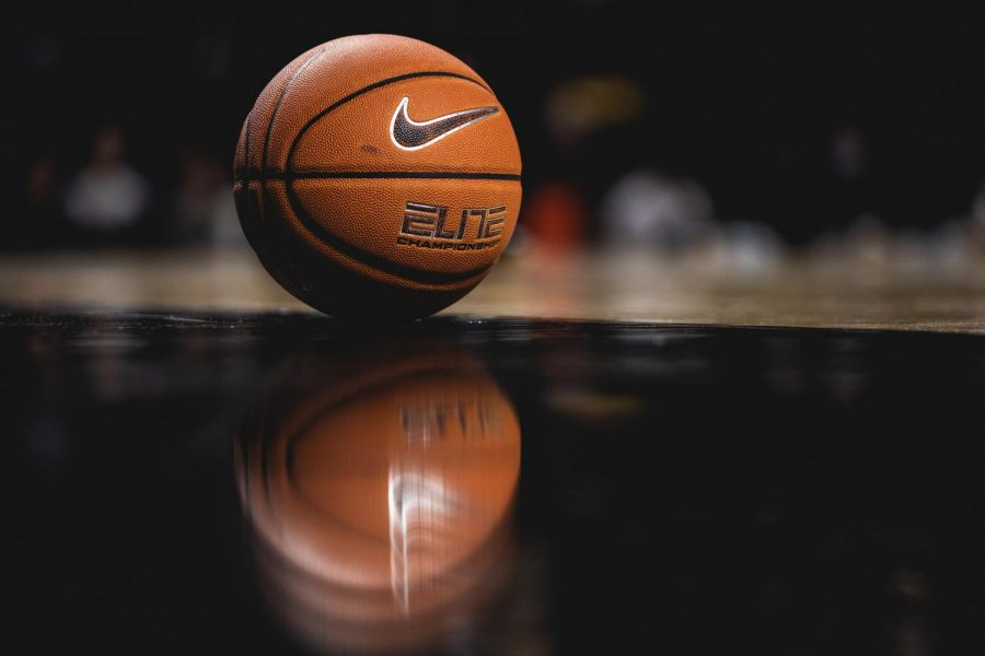 A basketball is shown on the court of Memorial Gym (Hustler Multimedia/Hunter Long)