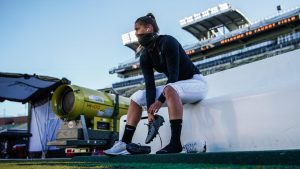 Sarah Fuller laces up her cleats prior to Vanderbilt's Nov. 28 contest at Missouri. (Vanderbilt Athletics)