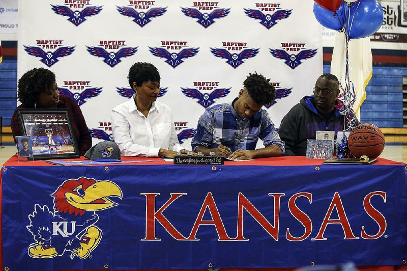 Issac McBride signs a letter of intent to play basketball at Kansas. He later transferred to Vanderbilt in 2020.(Mitchell PE Masilun)