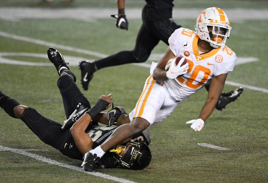 Jabari Small (20) runs over Jaylen Mahoney in Vanderbilt's 42-17 loss to Tennessee. (Tennessean/George Walker IV)
