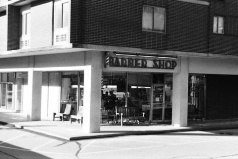 Exterior of Oxford Barber Shop in black and white