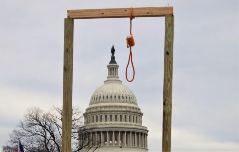 A gallows hangs near the United States Capitol during the storming of the United States Capitol on Jan. 6, 2021. (Creative Commons/Tyler Merbler)