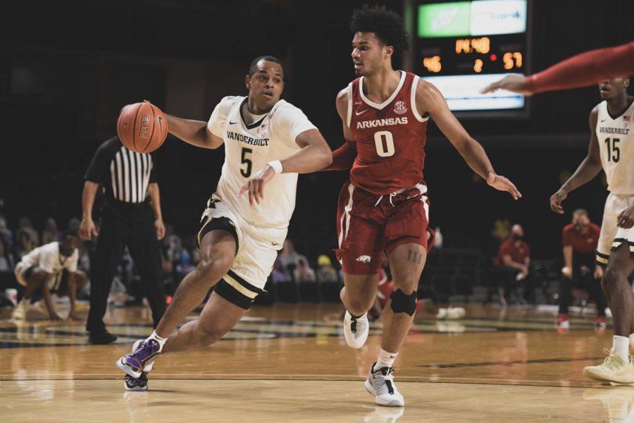 D.J. Harvey drives to the basket in Vanderbilt