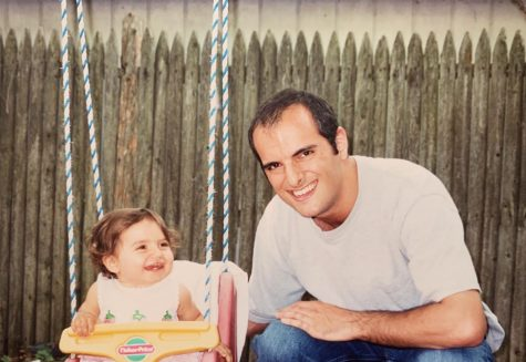 My uncle and I having fun on a swing set in 2003. (Photo courtesy of Rachael Perrotta)