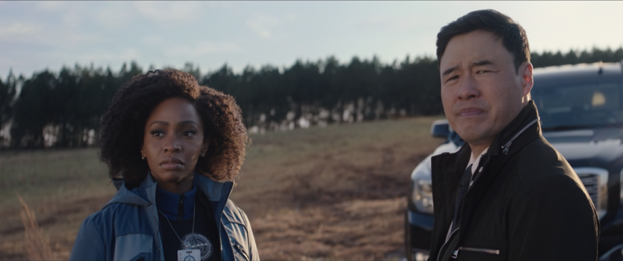Monica Rambeau (Teyonah Parris) stands outside the Westview anomaly with FBI Agent Jimmy Woo (Randall Park) from the