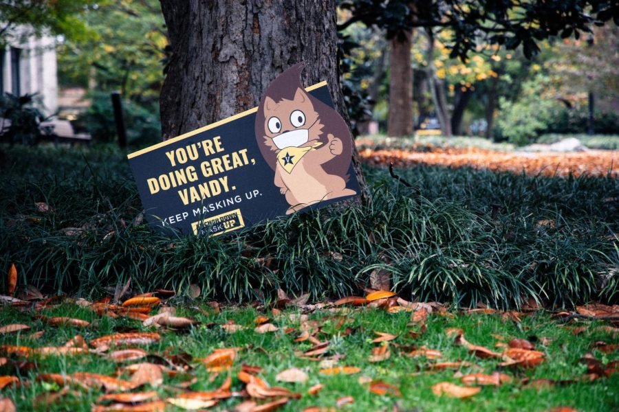 An on-campus sign featuring a masked squirrel reads