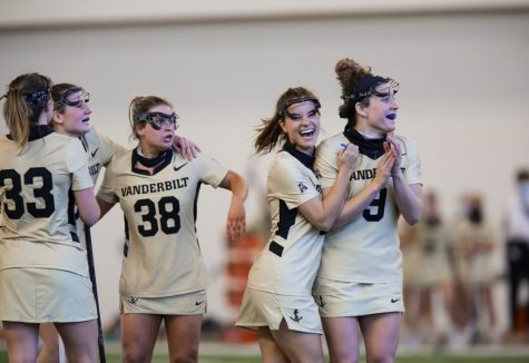Vanderbilt lacrosse celebrates its game-winning goal and subsequent upset over No. 24 Colorado. (Hustler Multimedia/Mattigan Kelly)