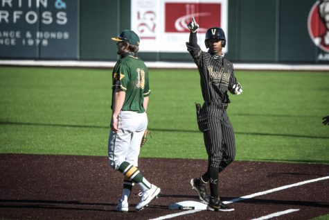 Enrique Bradfield Jr. reaches base against Wright State on Feb. 22, 2021. (Hustler Multimedia/Truman McDaniel)