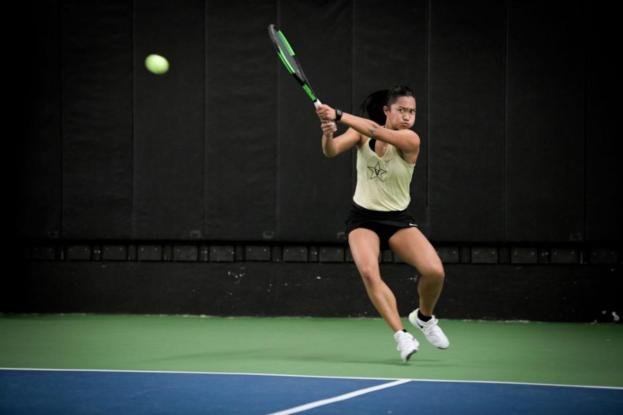 Marcella Crews hits a backhand Friday against Louisville.