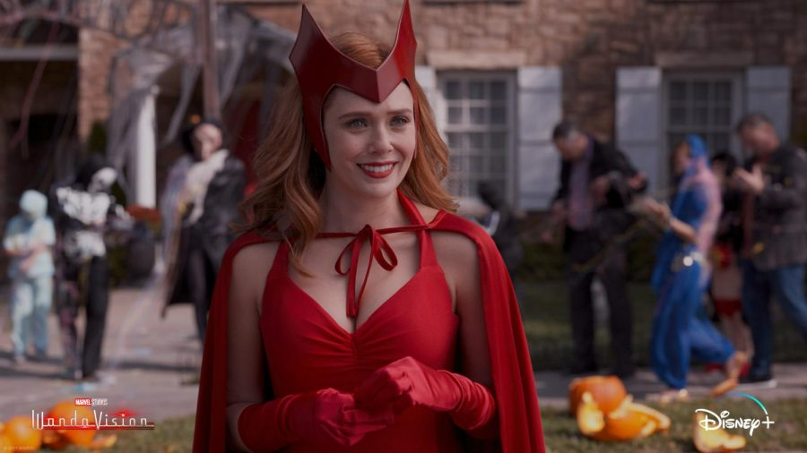 In episode 6's Halloween Spooktacular, Wanda's decked out in a classic Scarlet Witch costume as an homage to Marvel comics. But to fit the sitcom reality, she says she's dressed as a Sokovian fortune teller. (Marvel Studios/WandaVision)