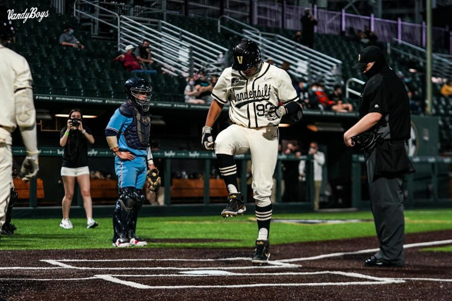 Jayson Gonzalez stomps on home plate after a solo home run against Belmont on March 16, 2021. (Twitter/@VandyBoys)