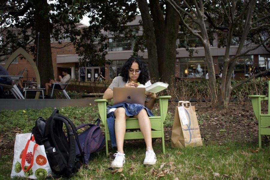 A Vanderbilt student sits outside to enjoy the spring weather on March 16, 2021 (Hustler Multimedia/Anjali Chanda)