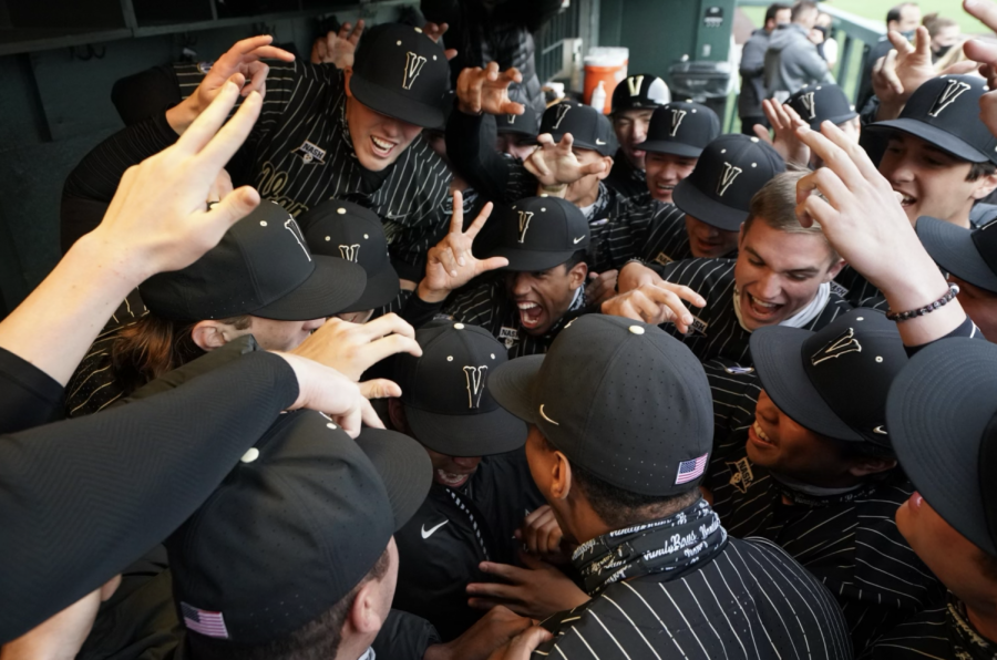The VandyBoys celebrate  in the dugout in their 15-0 victory over Illinois-Chicago on March 5. (Hustler Multimedia/Truman McDaniel)