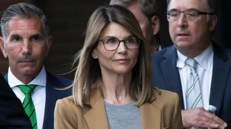 "Lori Laughlin leaves courthouse April 2019 after facing charges in national college admissions scheme, ""Operation Varsity Blues"" (Shutterstock/EPA-EFE/Katherine Taylor)"