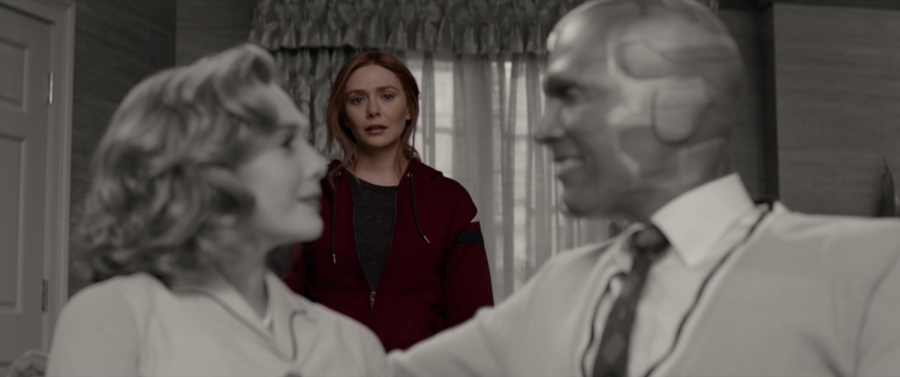 Wanda, in color, stares wistfully at the sitcom-perfect life she created for herself way back in episode one. It's taken so much to bring us to this moment, and it's about to come crashing down. (Marvel Studios/WandaVision)
