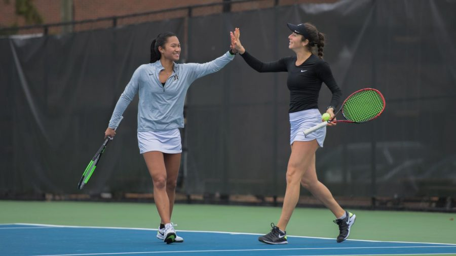Marcella Cruz and Emma Kurtz celebrate their doubles victory over Georgia on March 28, 2021. (Twitter/@VandyWTennis)