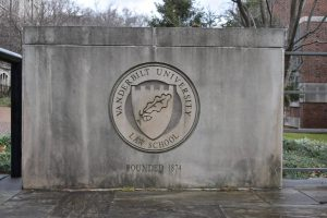 an image of the Vanderbilt Law School emblem on the wall of the building