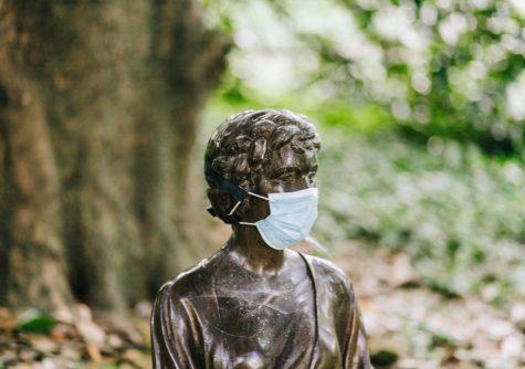 Statue wearing mask