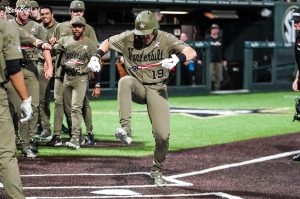 Troy LaNeve stomping on home plate after a home run against Georgia Tech (Twitter/@VandyBoys).